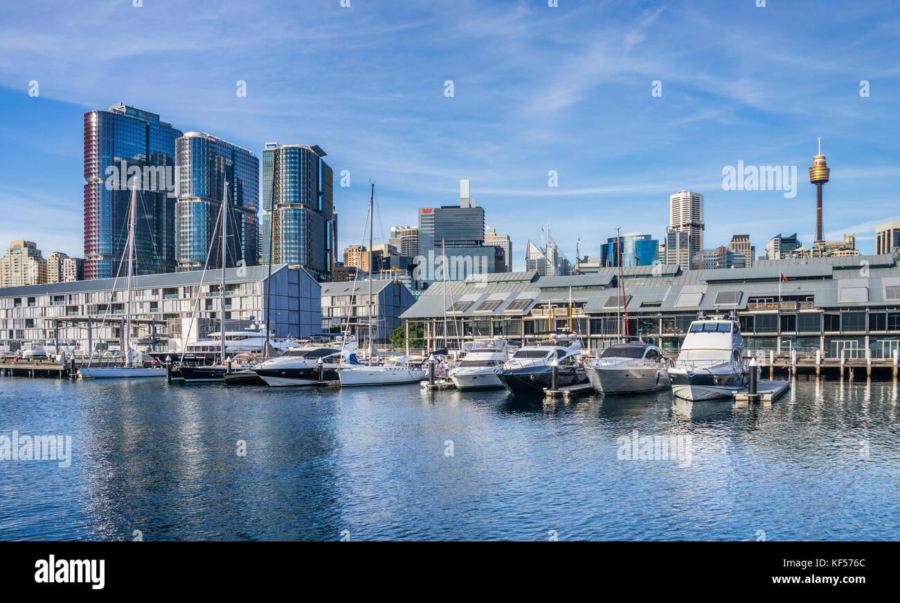 Australia, New South Wales, Sydney, Sydney Wharf marina against the backdrop of the Barangaroo International Towers - Stock Image