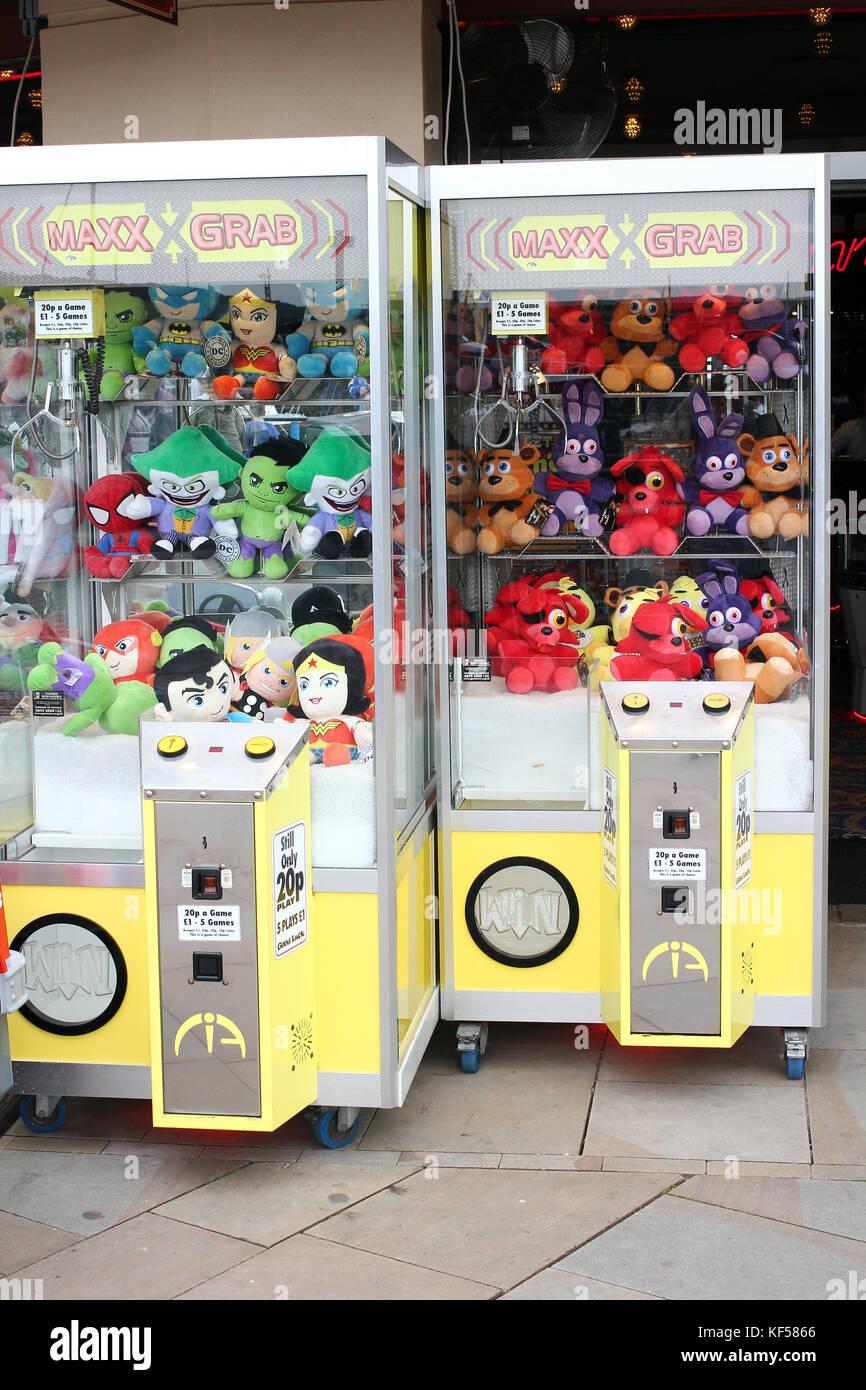 Claw grabber amusement machine - Stock Image