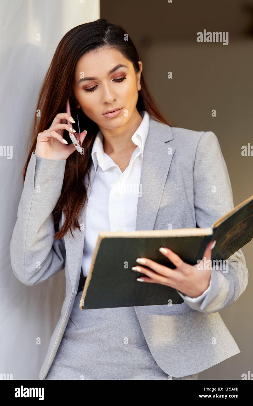 Stressed woman at work - Stock Image