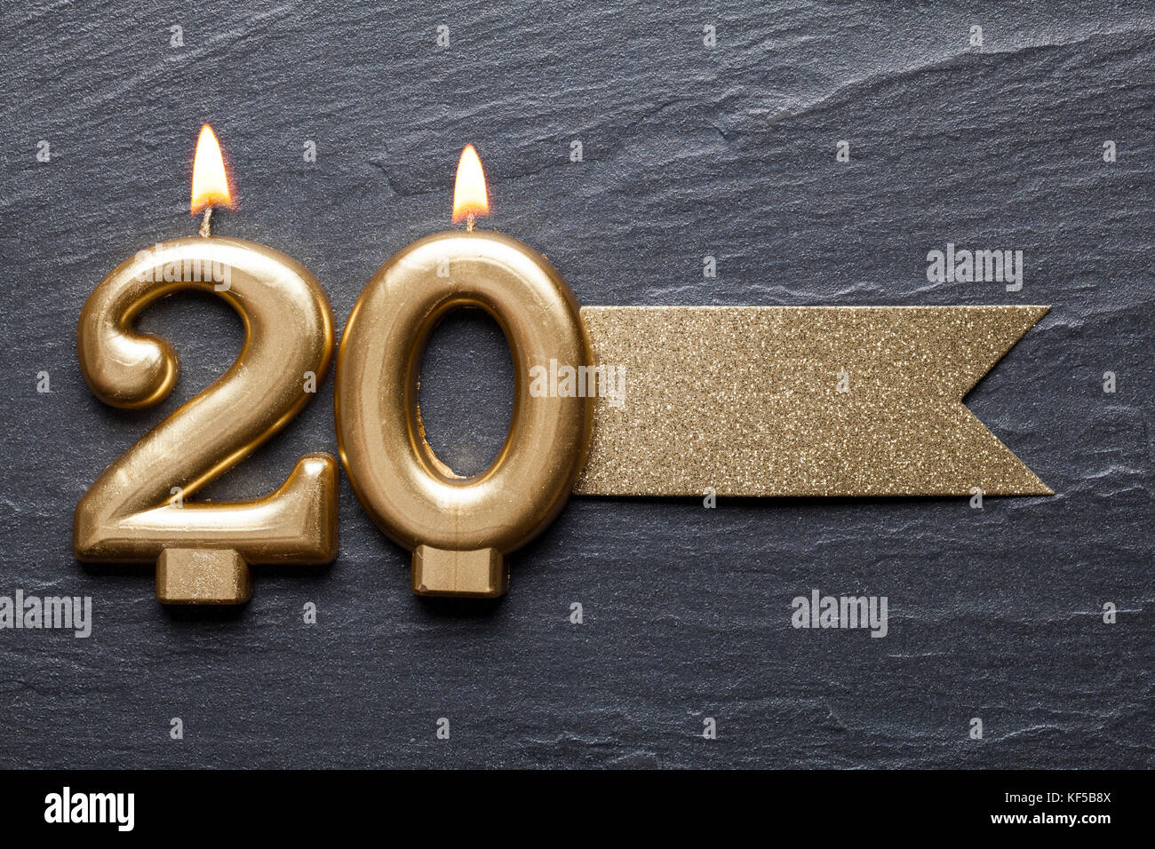 Gold number 20 celebration candle with glitter label - Stock Image