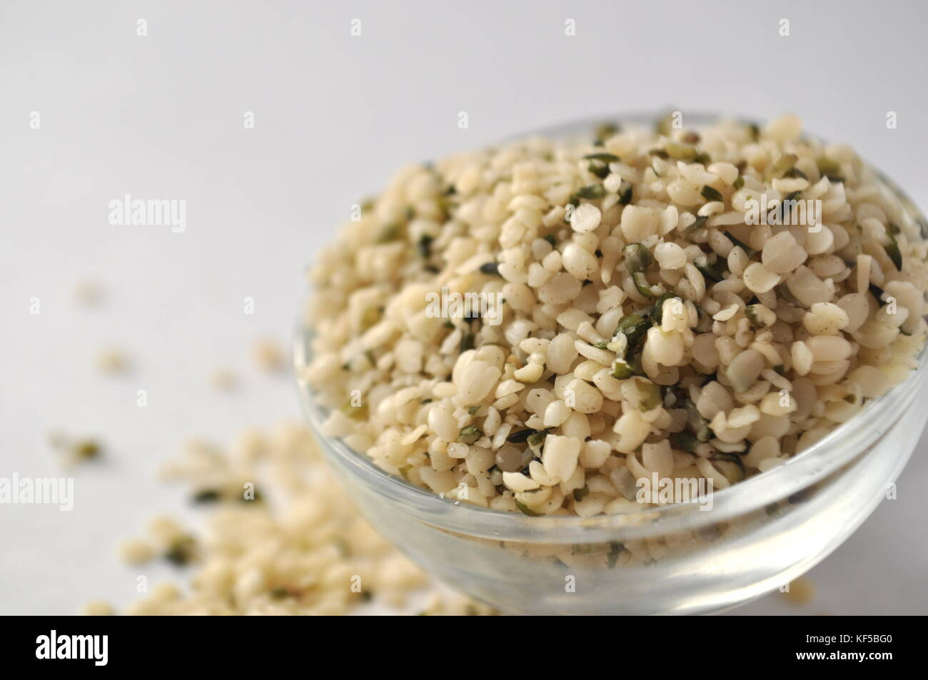 Hemp (Cannabis sativa) seeds or heart - natural and nutritious dietary supplement suitable for vegans, vegetarians, - Stock Image