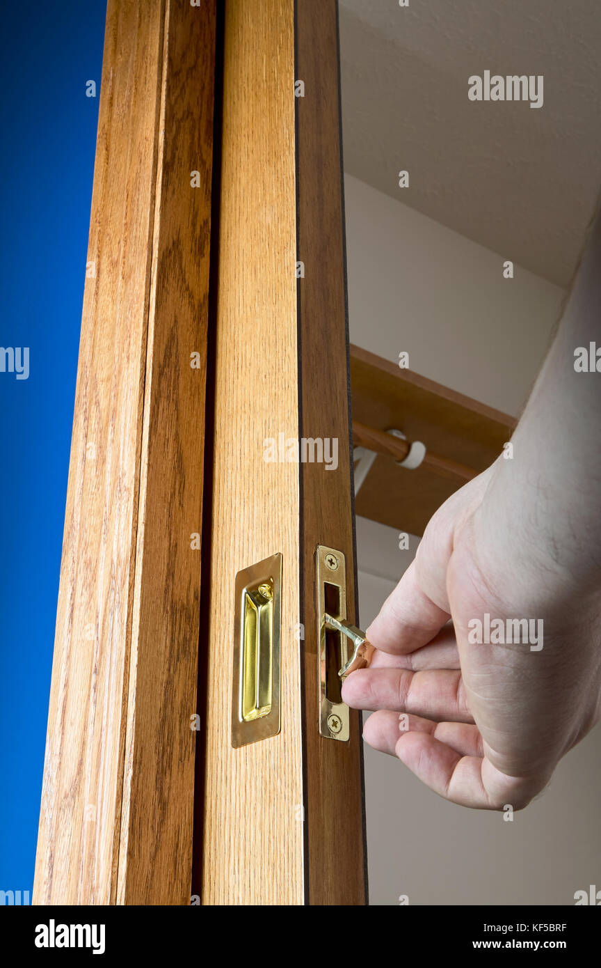 Attrayant Open Pocket Door With Male Hand Holding The Pull Edge Lever On The Handle  With The Door Concealed Inside The Wall Cavity In A Low Angle View