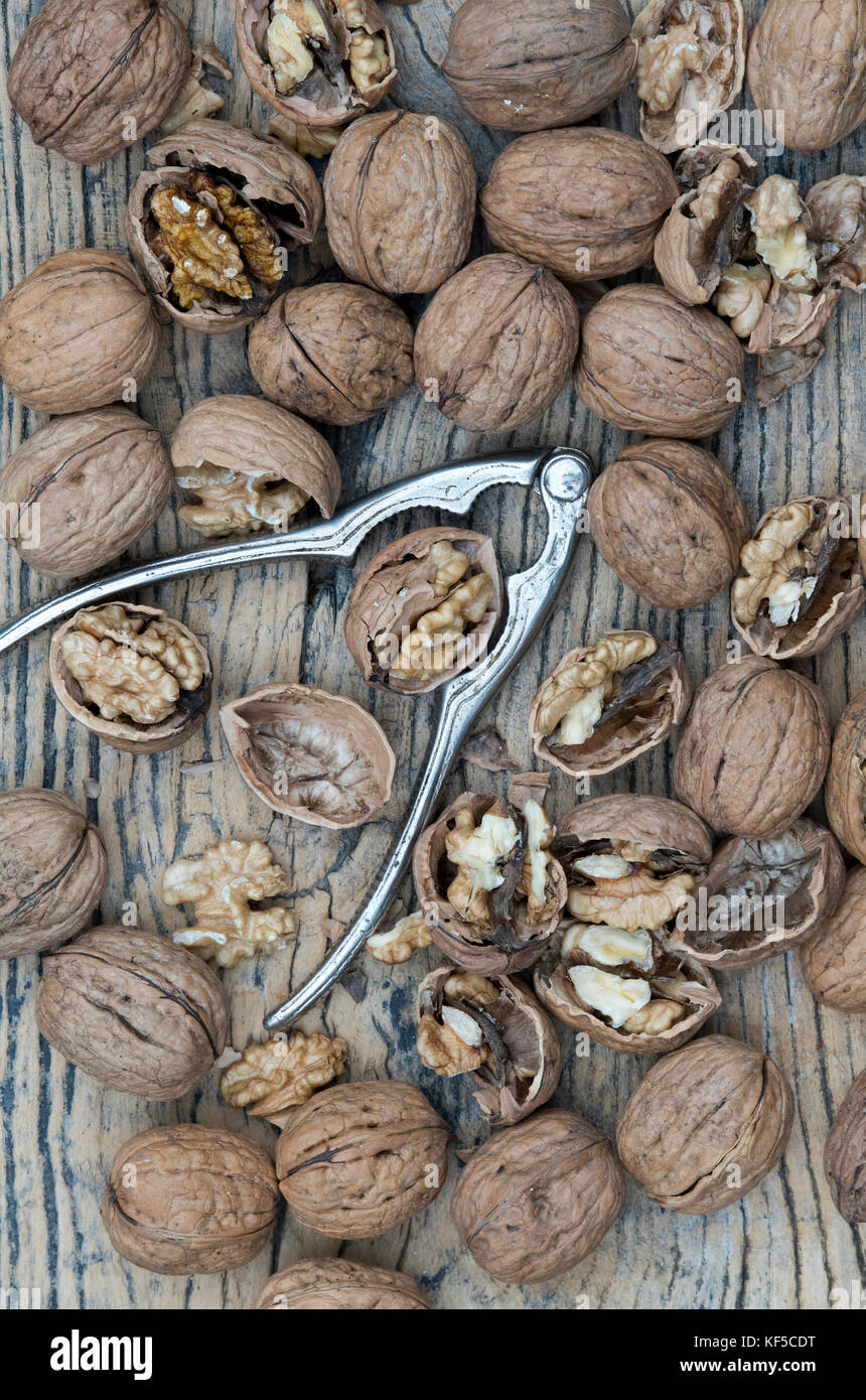 Walnuts and nutcrackers - Stock Image