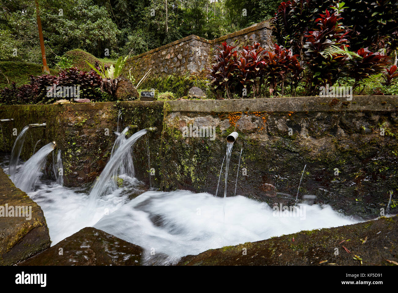 Water springs in the Mengening Temple. Tampaksiring, Bali, Indonesia. - Stock Image