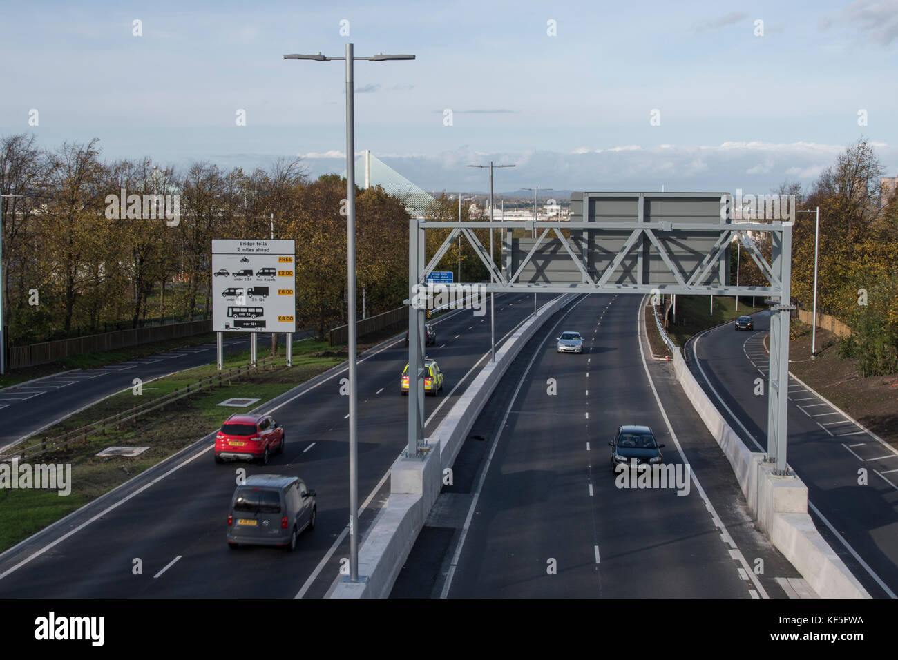 Mersey Gateway toll bridge approach road with traffic heading to and from the toll bridge across the River Mersey - Stock Image