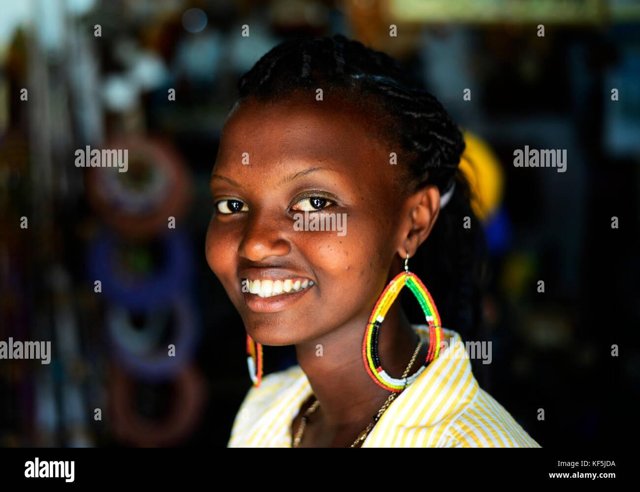 Portrait of a smiling Tanzanian woman. - Stock Image