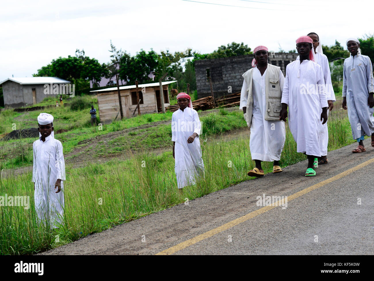 Tanzanian Muslim youth dressed in Arab clothing as many schools are funded by the rich gulf countries. - Stock Image