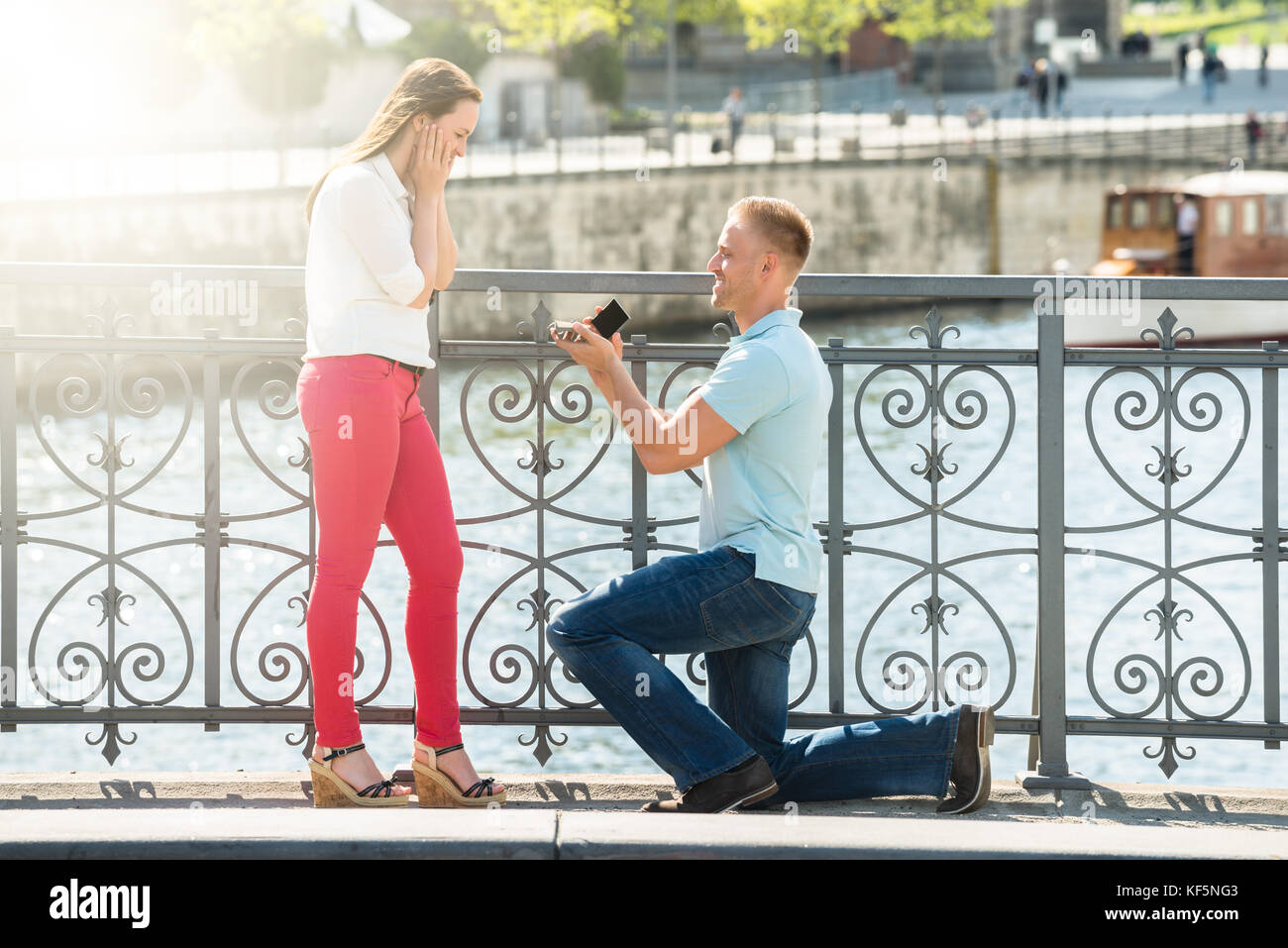 Young Man With Ring Making Proposal To Woman - Stock Image