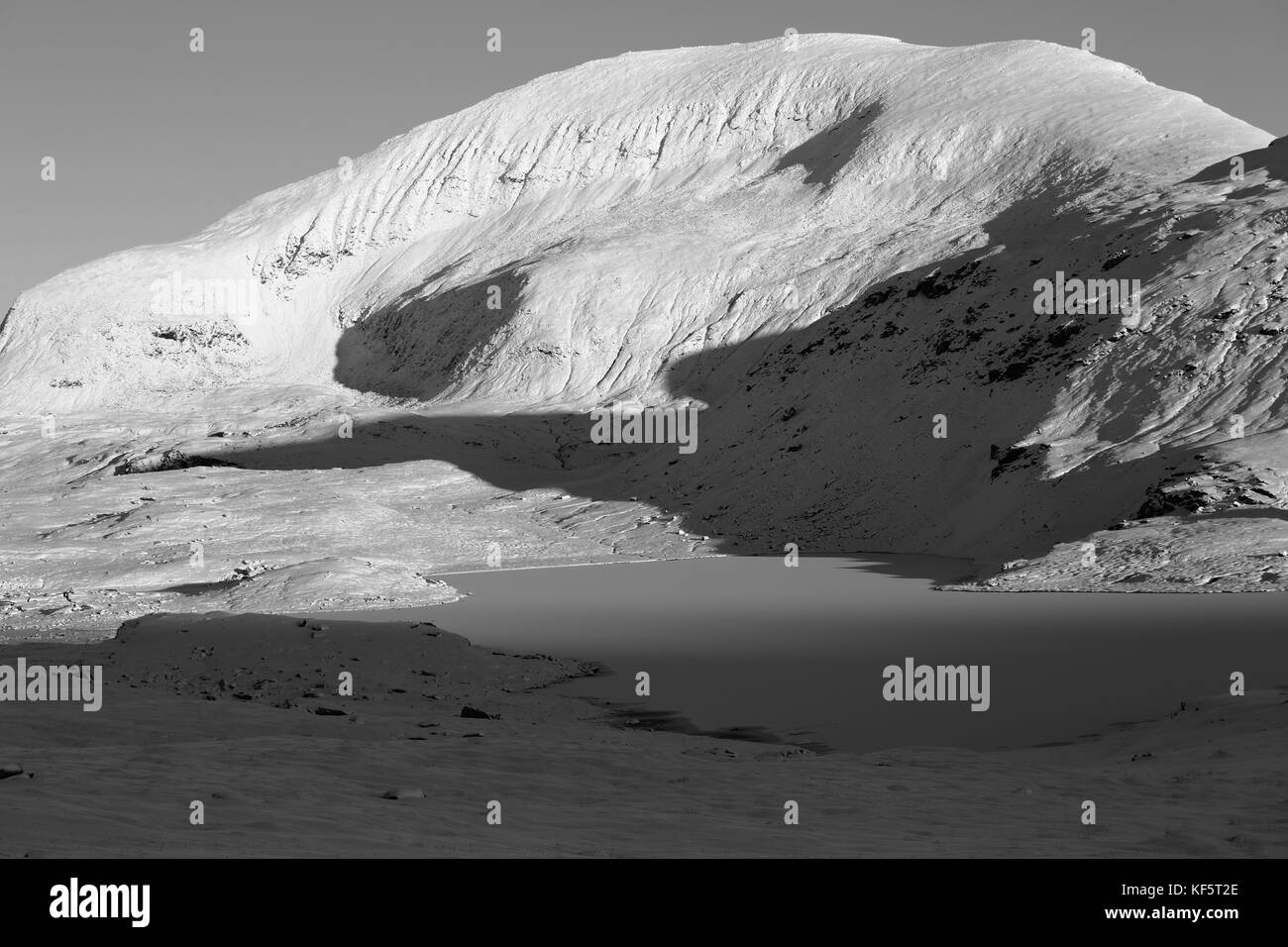 Tromsdalstind Covered In Snow In Autumn Sun - Stock Image