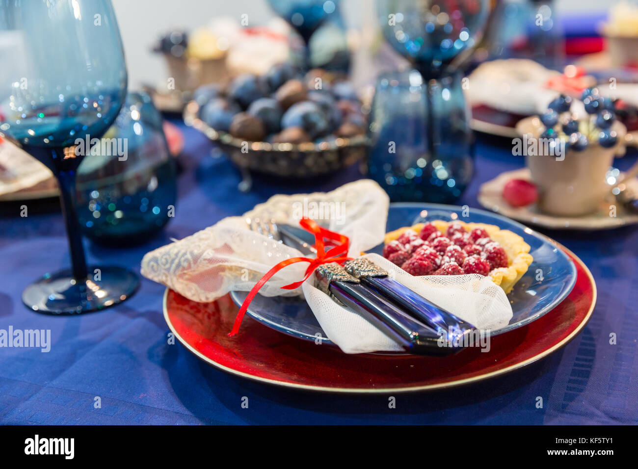 Table with food decoration closeup, nobody - Stock Image