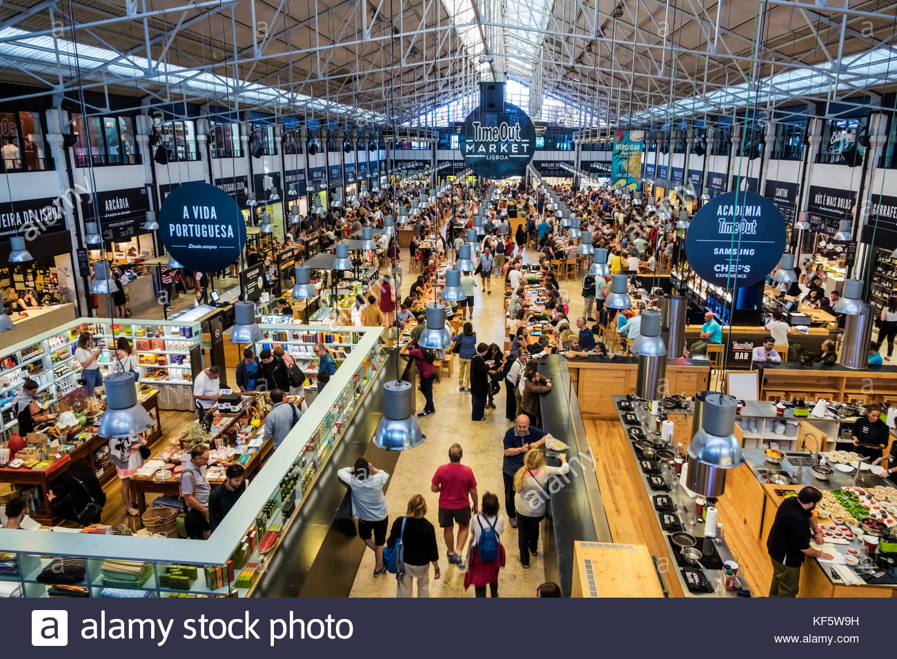 Lisbon Portugal Cais do Sodre Mercado Da Ribeira Time Out Market market  hall food court dining tables crowded busy aisles overhead view Hispanic  resta 782f470fb6258