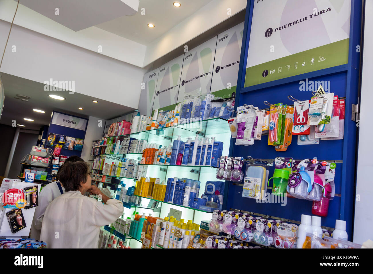 Lisbon Portugal Bairro Alto Farmacia Oliveira Grupo Progresso pharmacy drug store woman shopping childcare products - Stock Image