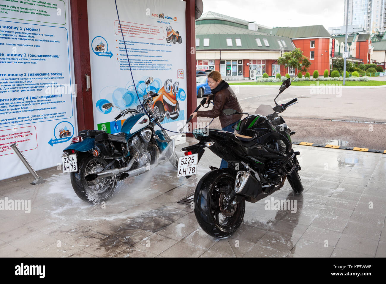 Girl in car wash stock photos girl in car wash stock images alamy saint petersburg russia circa okt 2017 woman wash two motorcycles on solutioingenieria Gallery