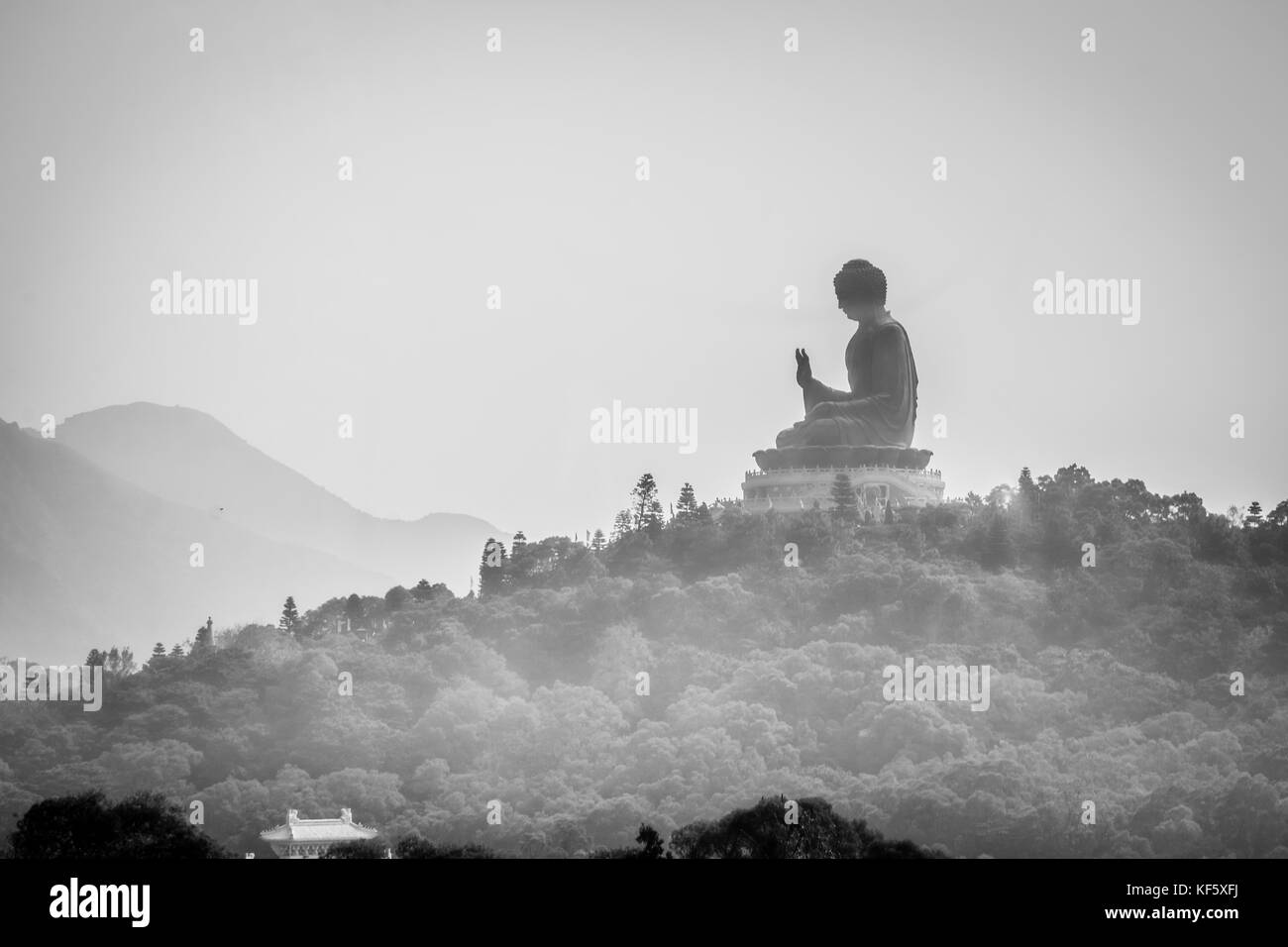 Tian Tan Buddha, also known as the Big Buddha, is a large bronze statue of a Buddha Amoghasiddhi, located at Ngong - Stock Image