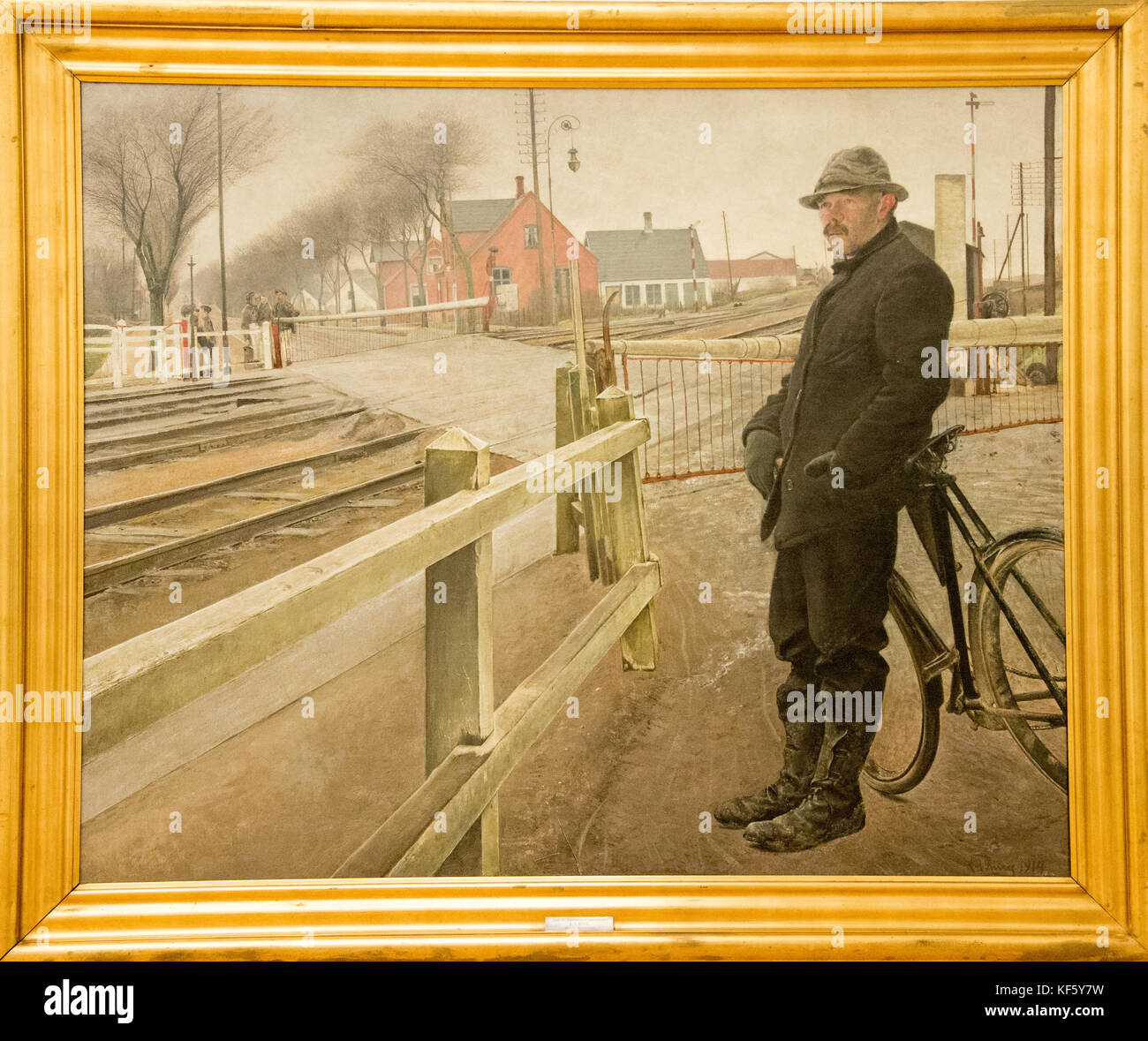 'waiting for the train. levelcrossing by Roskilde Highway' by Laurits Andersen Ring - Stock Image