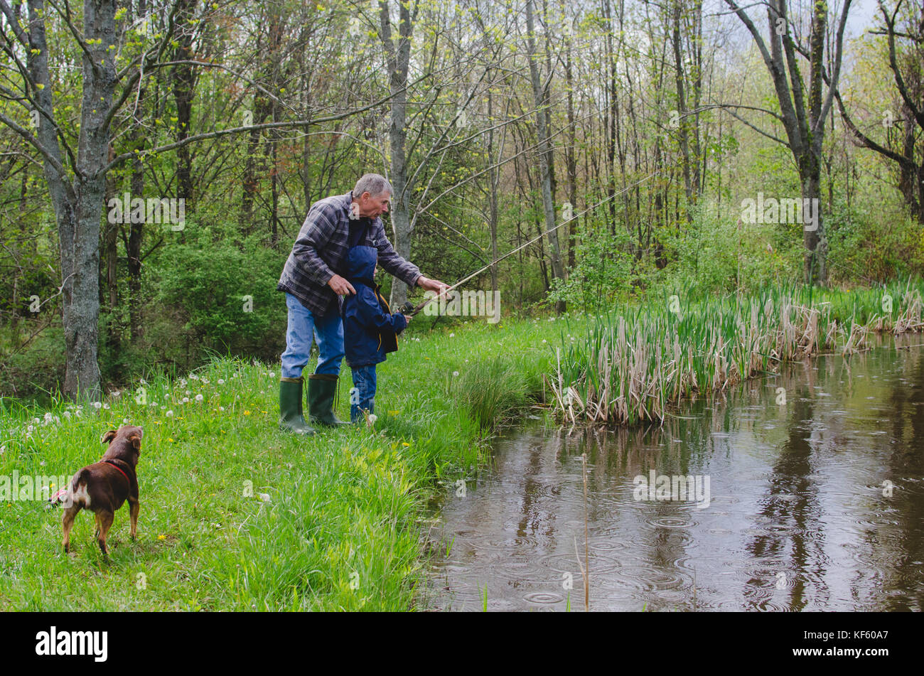 A grandfather and grandson fishing - Stock Image