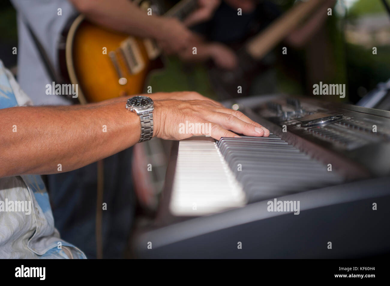 Musician's hands playing electric piano - Stock Image