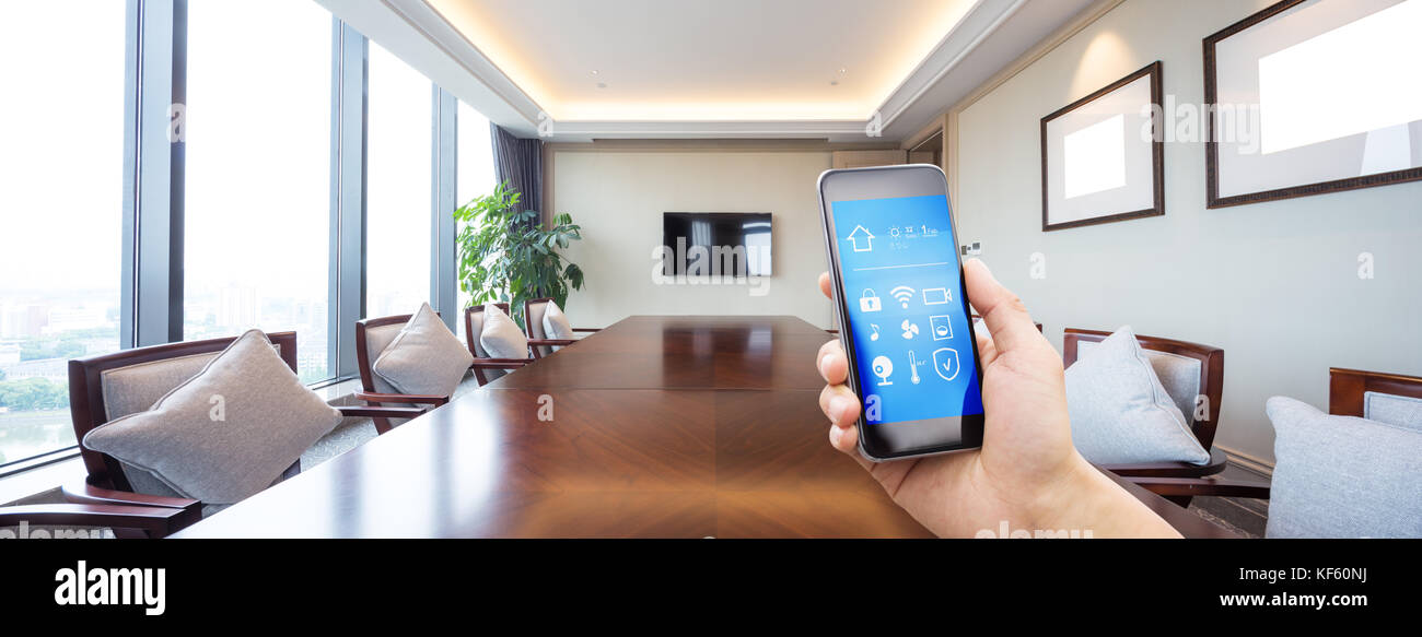 mobile phone with apps on smart home in modern meeting room