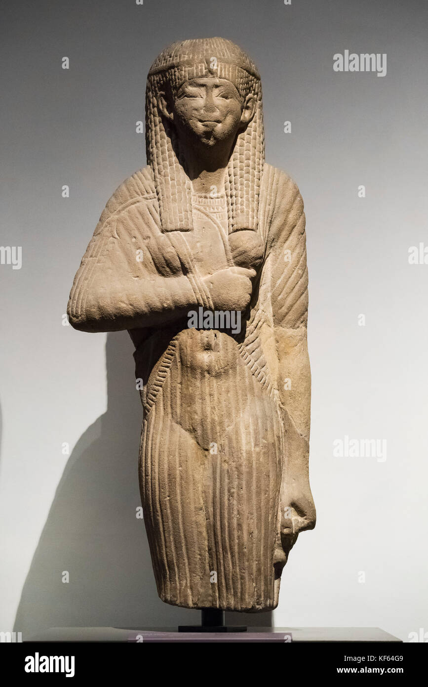 Turin. Italy. Statue of an Egyptian queen wearing a wig and diadem and clinging draped dress. Ptolemaic Period (332 Stock Photo