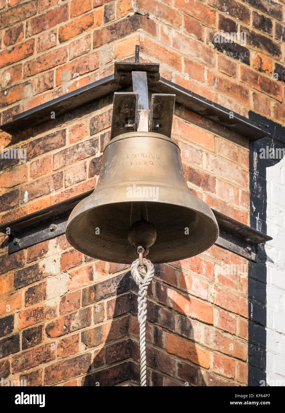 The Atlas Bell, Gloucester Docks. The bell of the Atlas ship, launched in 1812. Later in 1832 it signalled the dockers - Stock Image