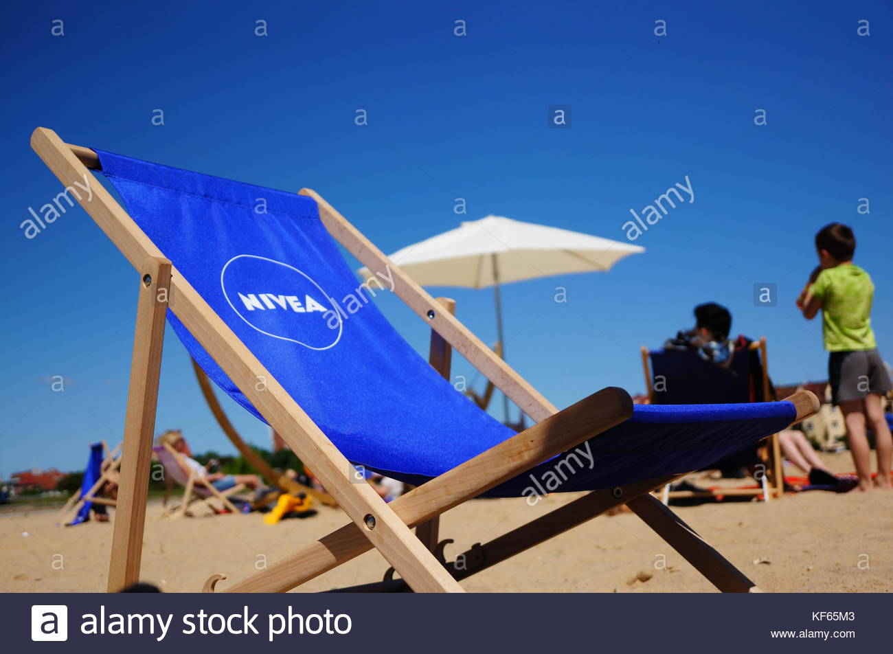 POZNAN, POLAND - JUNE 04, 2015: Blue sun bed with Nivea logo at a city beach - Stock Image