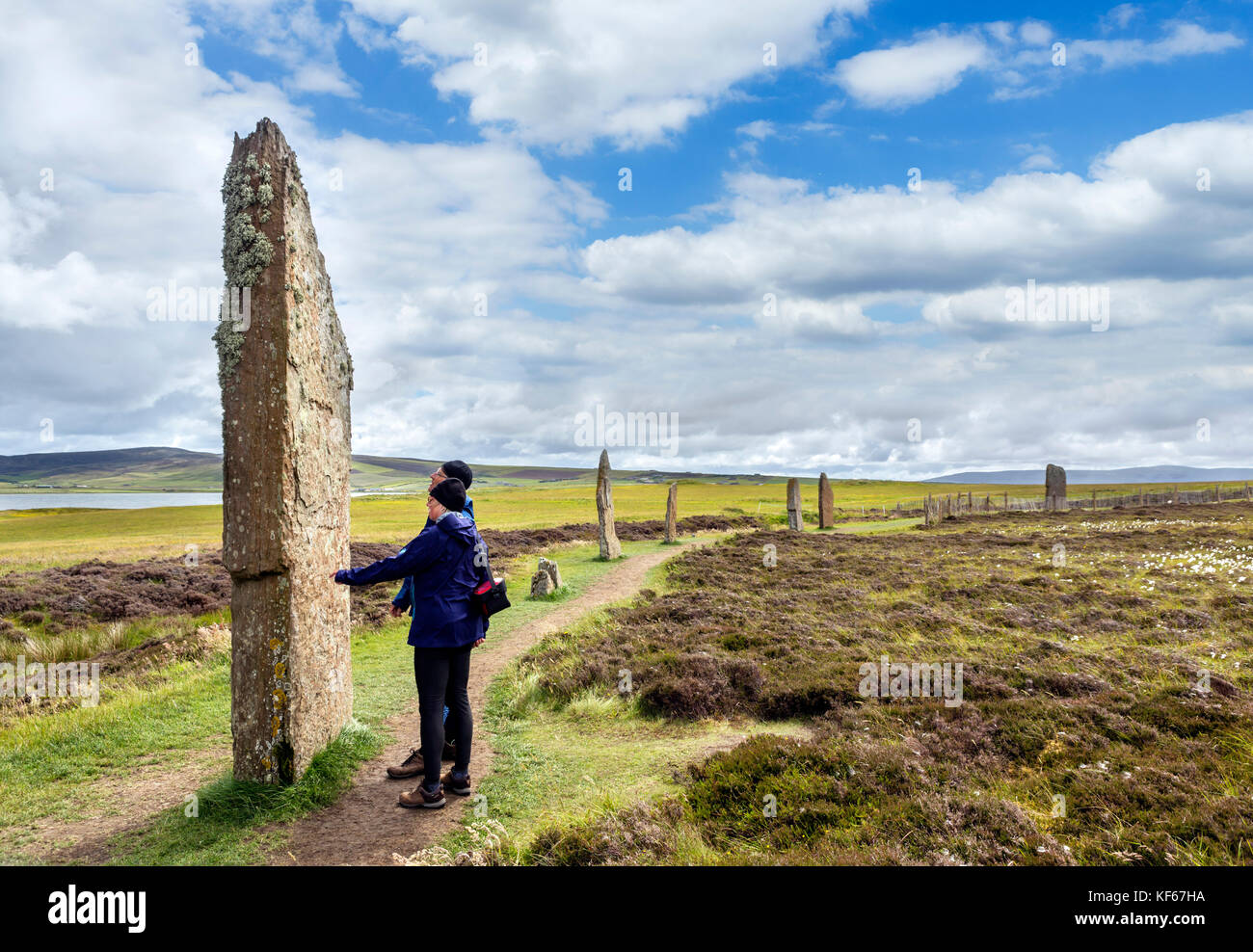 Tourists at the Ring of Brodgar, Orkney. Neolithic stone circle, dating from around 2000 to 2500 BC, Mainland, Orkney, Stock Photo