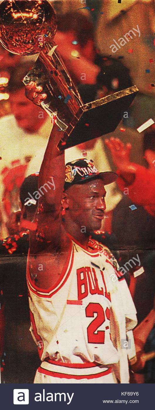 Michael Jordan 1963 Chicago Bulls Basketball Star Holds Up The Trophy After