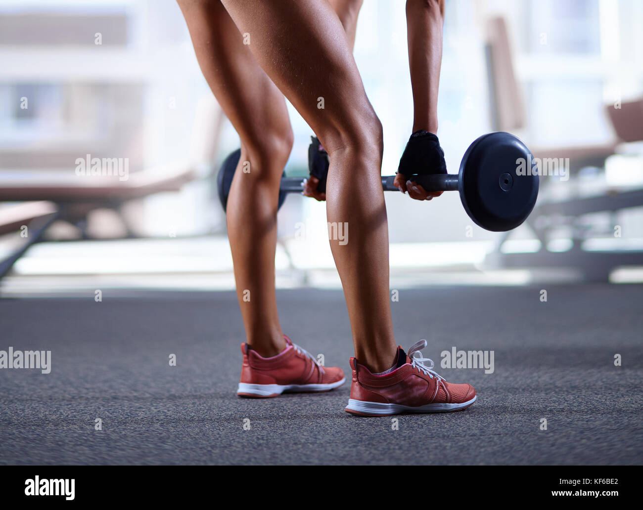 Woman working out in the gym - Stock Image