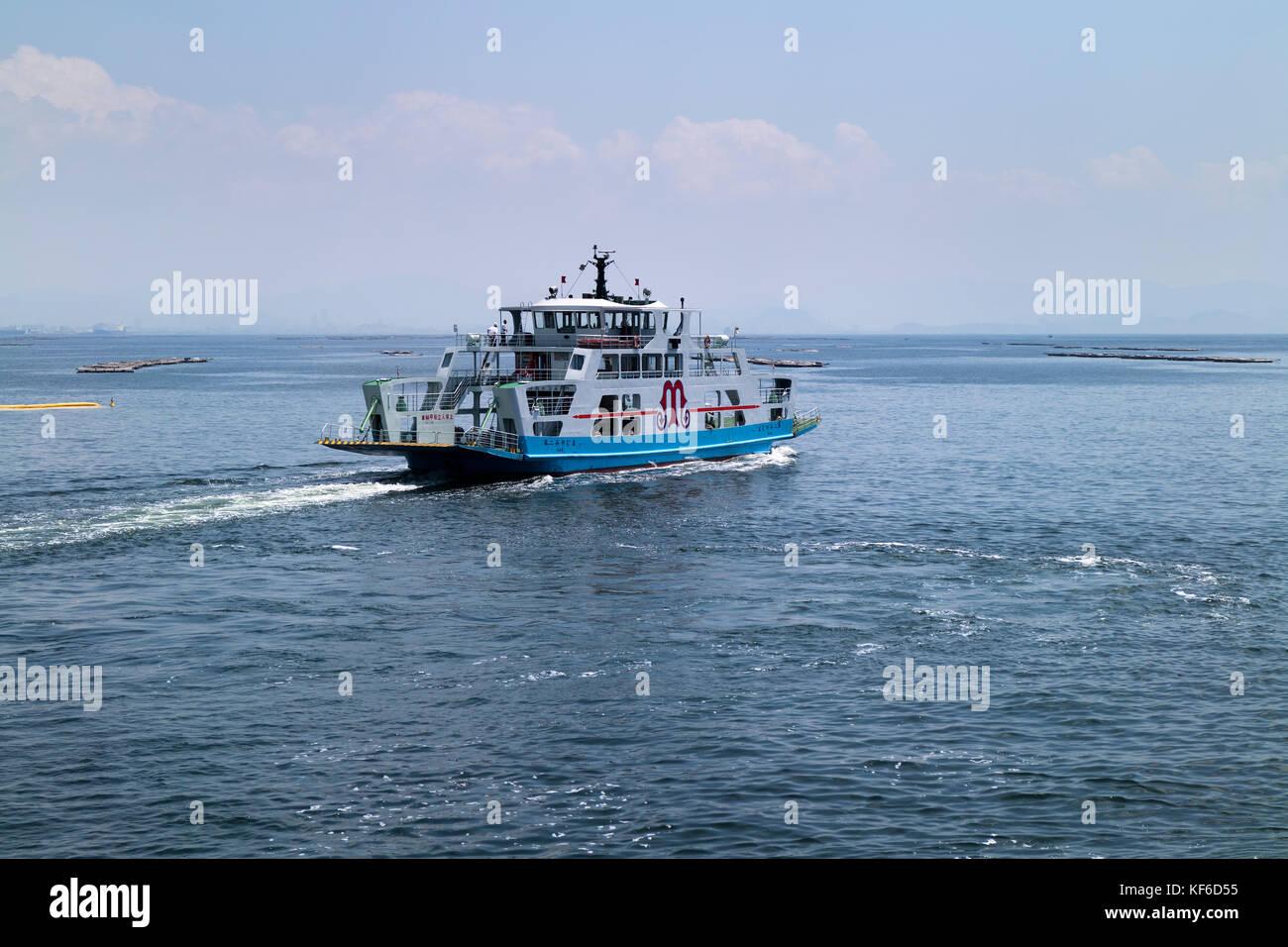 Hiroshima, Japan -  May 26, 2017: A ferry on Seto Inland Sea running to Miyajima Island in Hiroshima, Japan - Stock Image