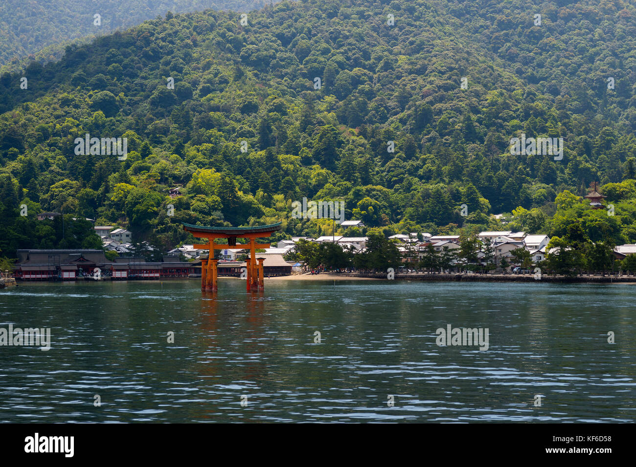 Miyajima - Japan, May 26, 2017: Red Torii gate of the Itsukushima Shrine in the sea near Miyajima - Stock Image