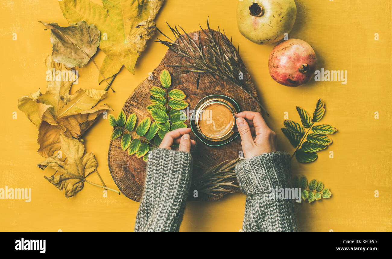 Woman' s hands cup of espresso over yellow background - Stock Image