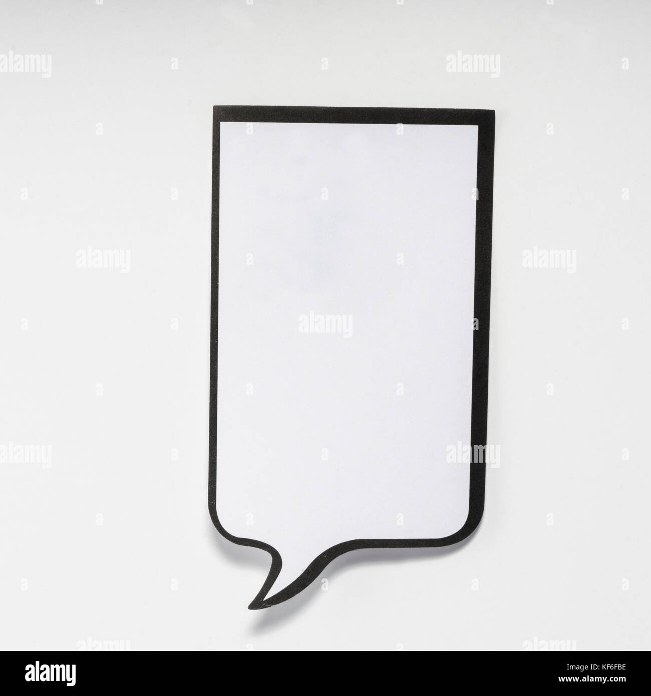 a white memo pad with the shape of a comic without inscriptions - Stock Image