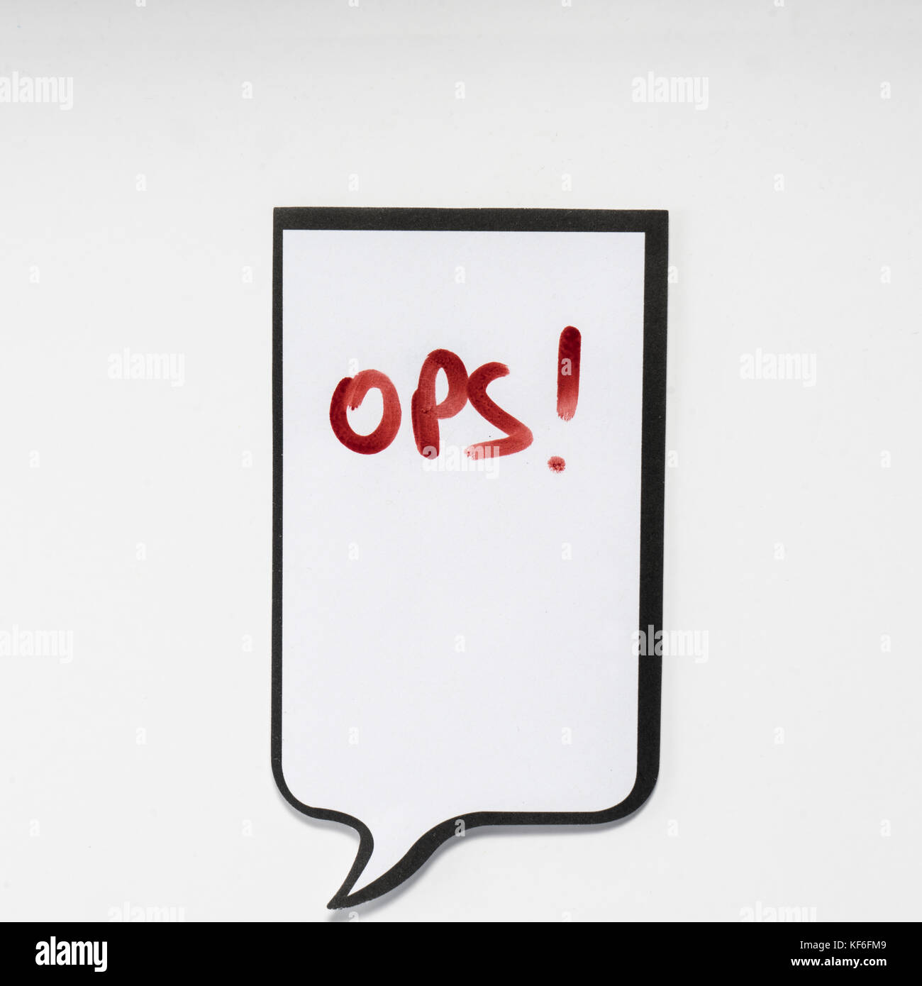 a white memo pad with the shape of a comic with the inscription 'ops' - Stock Image