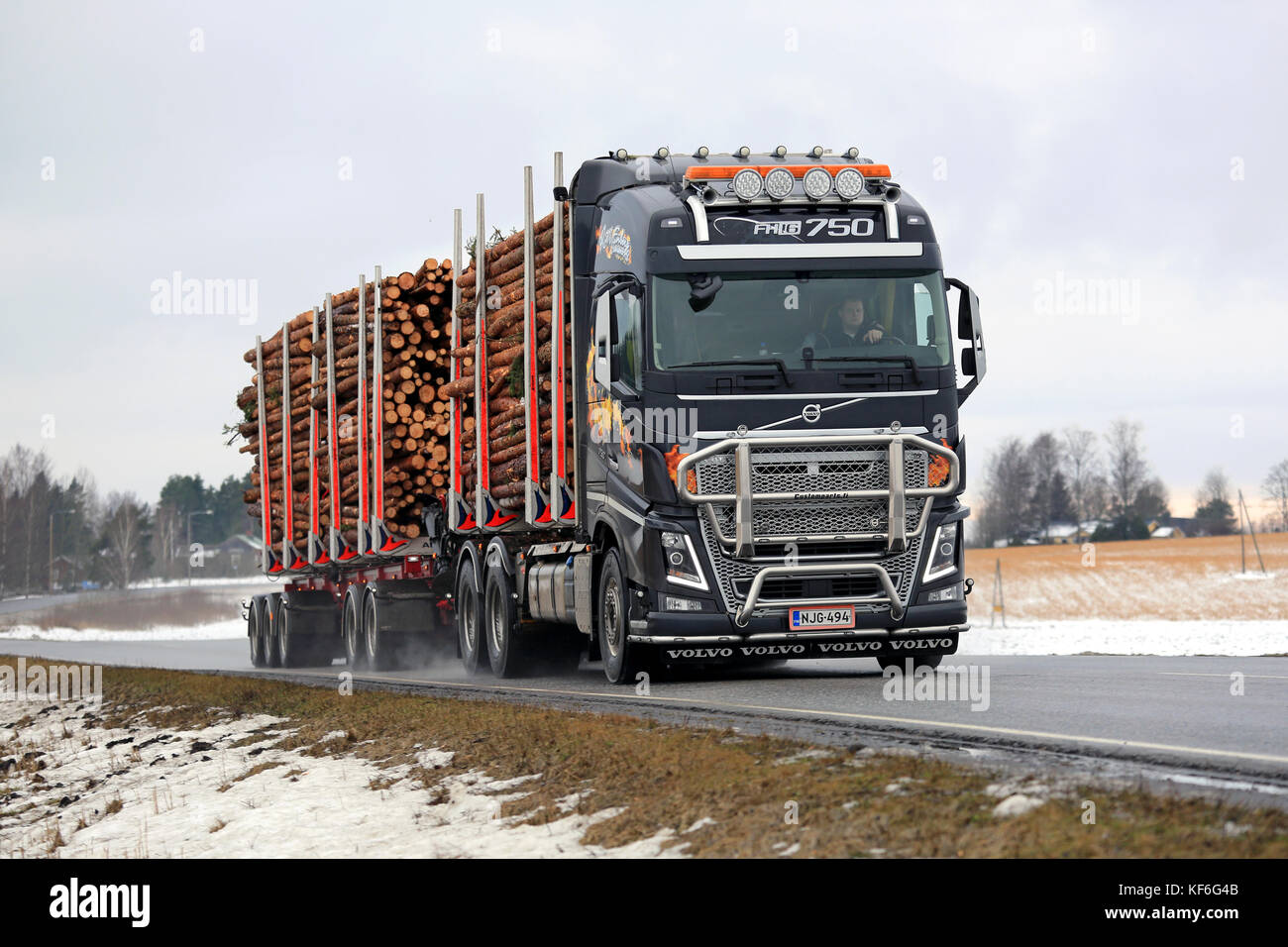 SALO, FINLAND -  FEBRUARY 19, 2016: Volvo FH16 750 logging truck hauls pulp wood along highway in South of Finland. Stock Photo