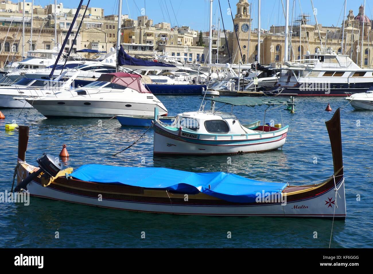 Traditional Maltese wooden fishing boats.anchored at Marsaxlokk, Birzebbuga, Senglea  & Xlendi, Gozo. Malta. - Stock Image