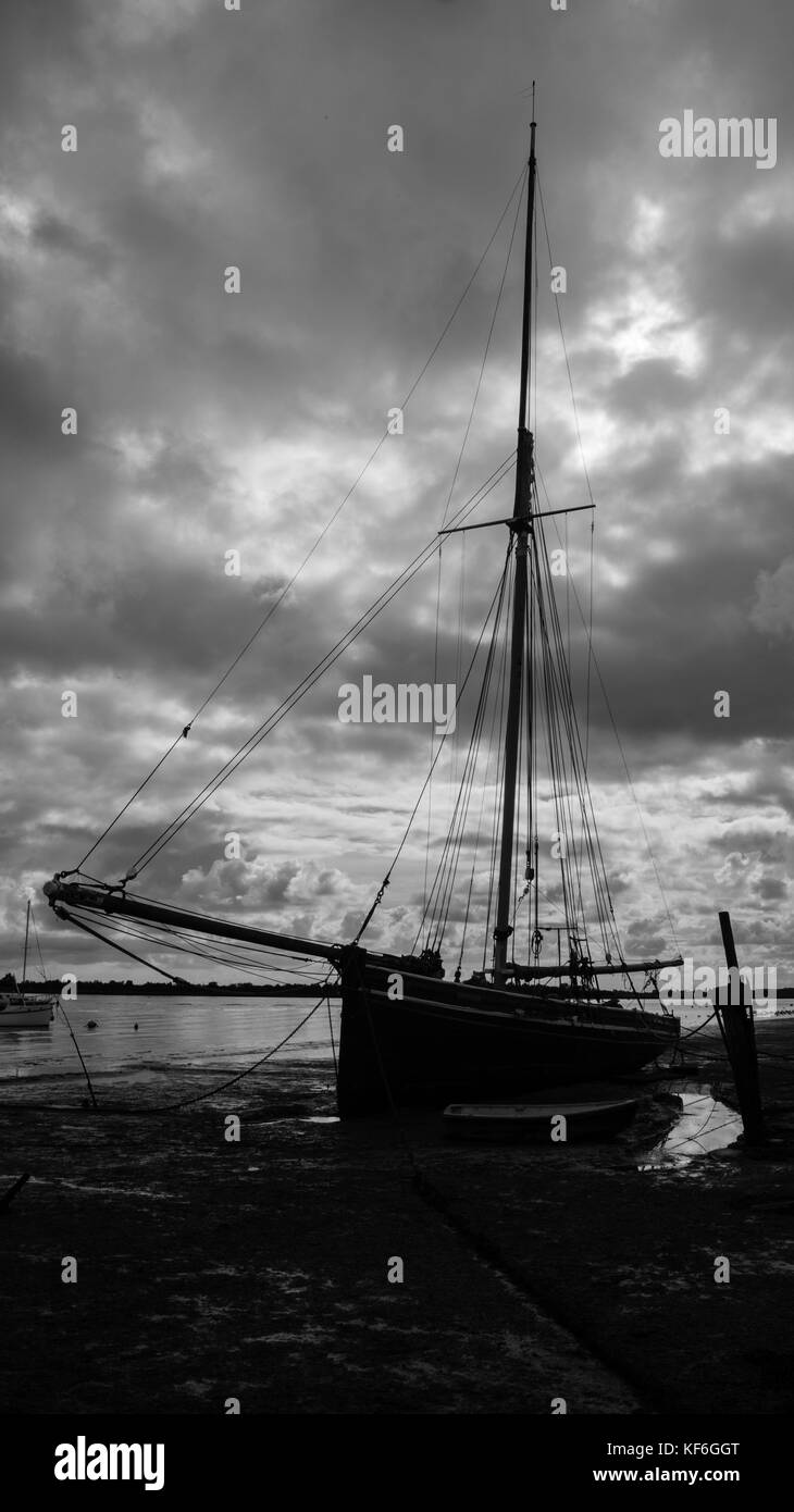 Vintage Yacht at Low Tide in black and white - Stock Image