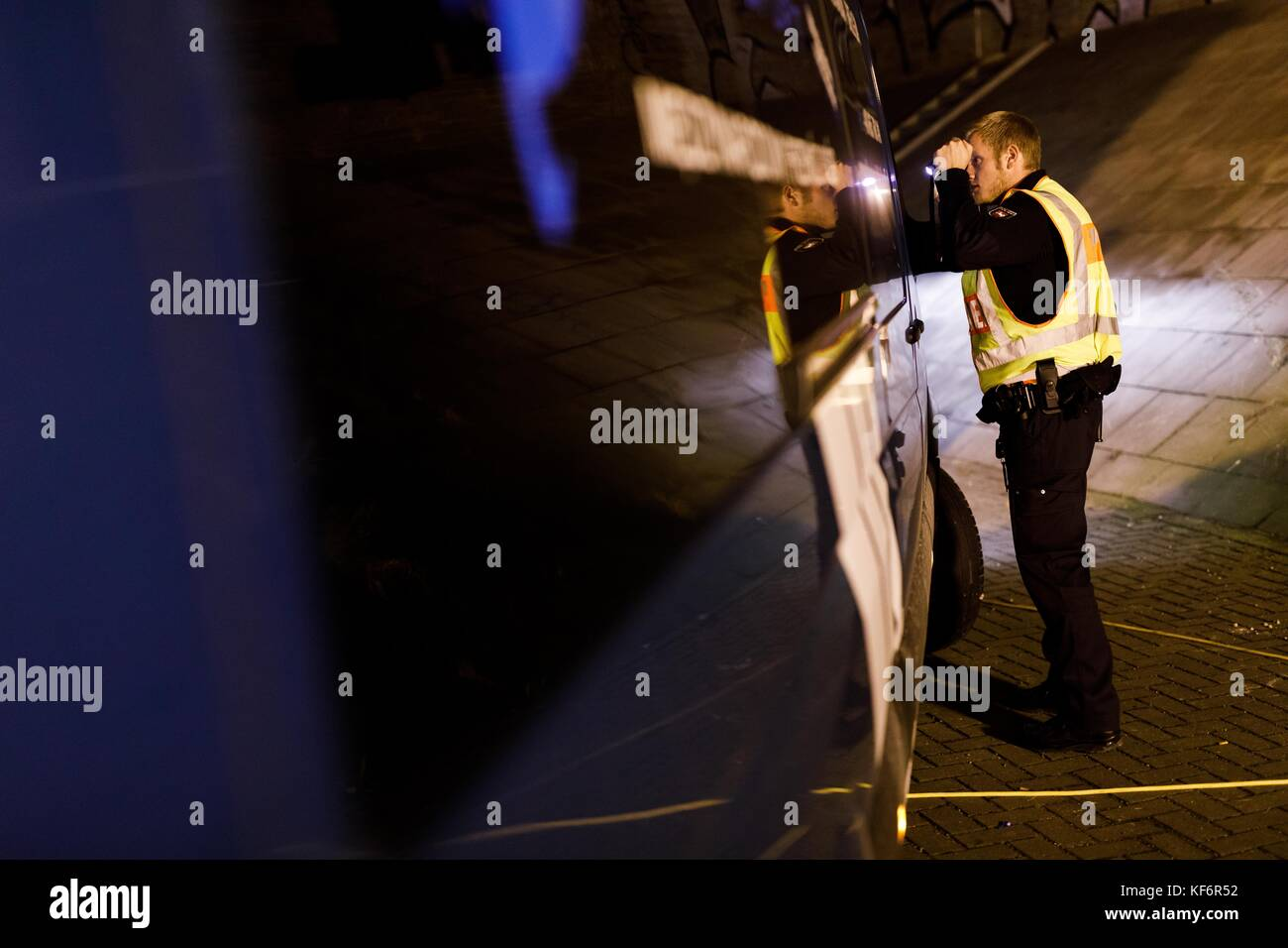 Police officers carry out roadside inspections of vehicles passing through Lehrte, Germany, 26 October 2017. The - Stock Image