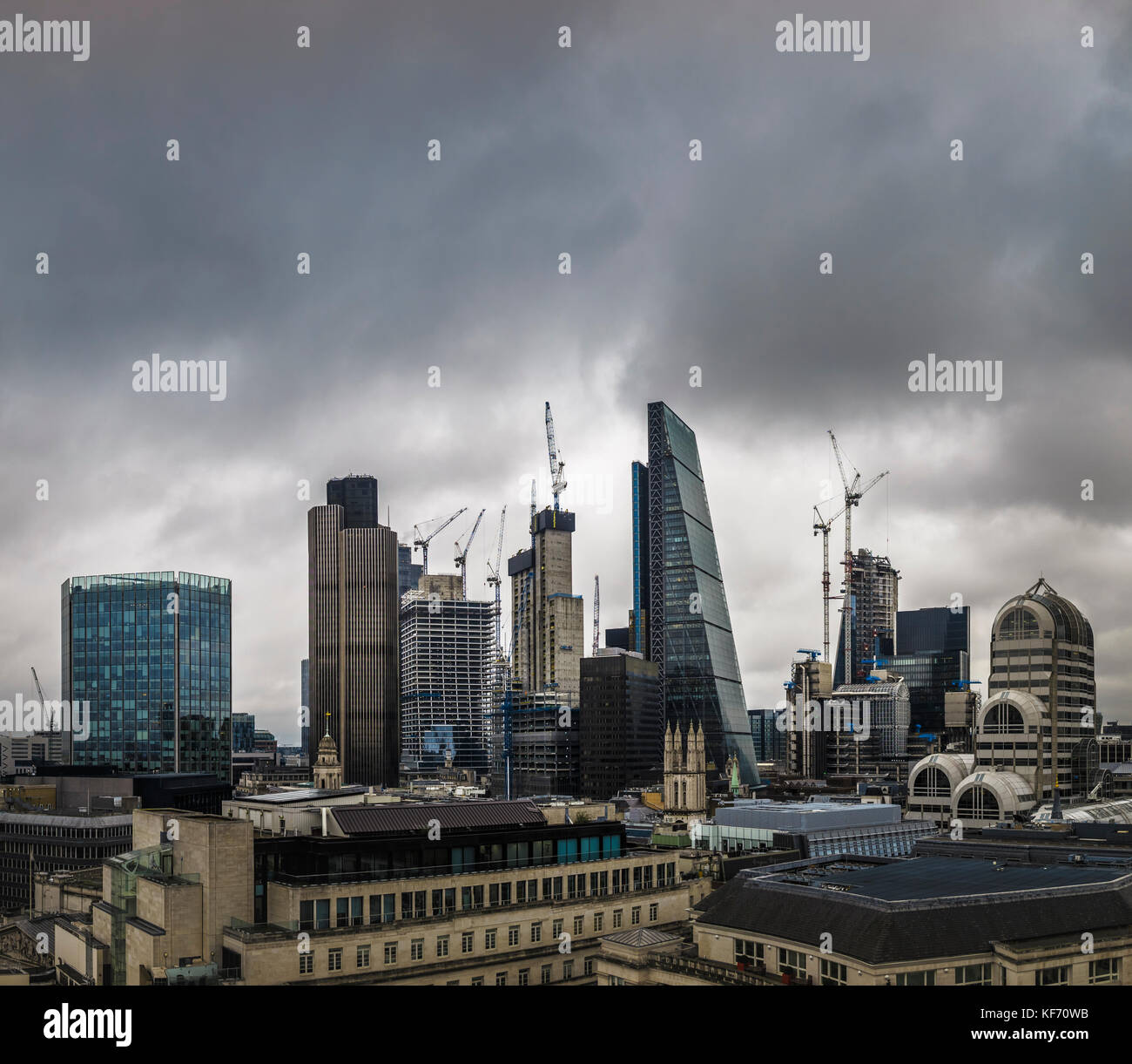 City of London, London, UK, 26th October 2017.  Sombre dark clouds gather over iconic modern buildings on the skyline - Stock Image