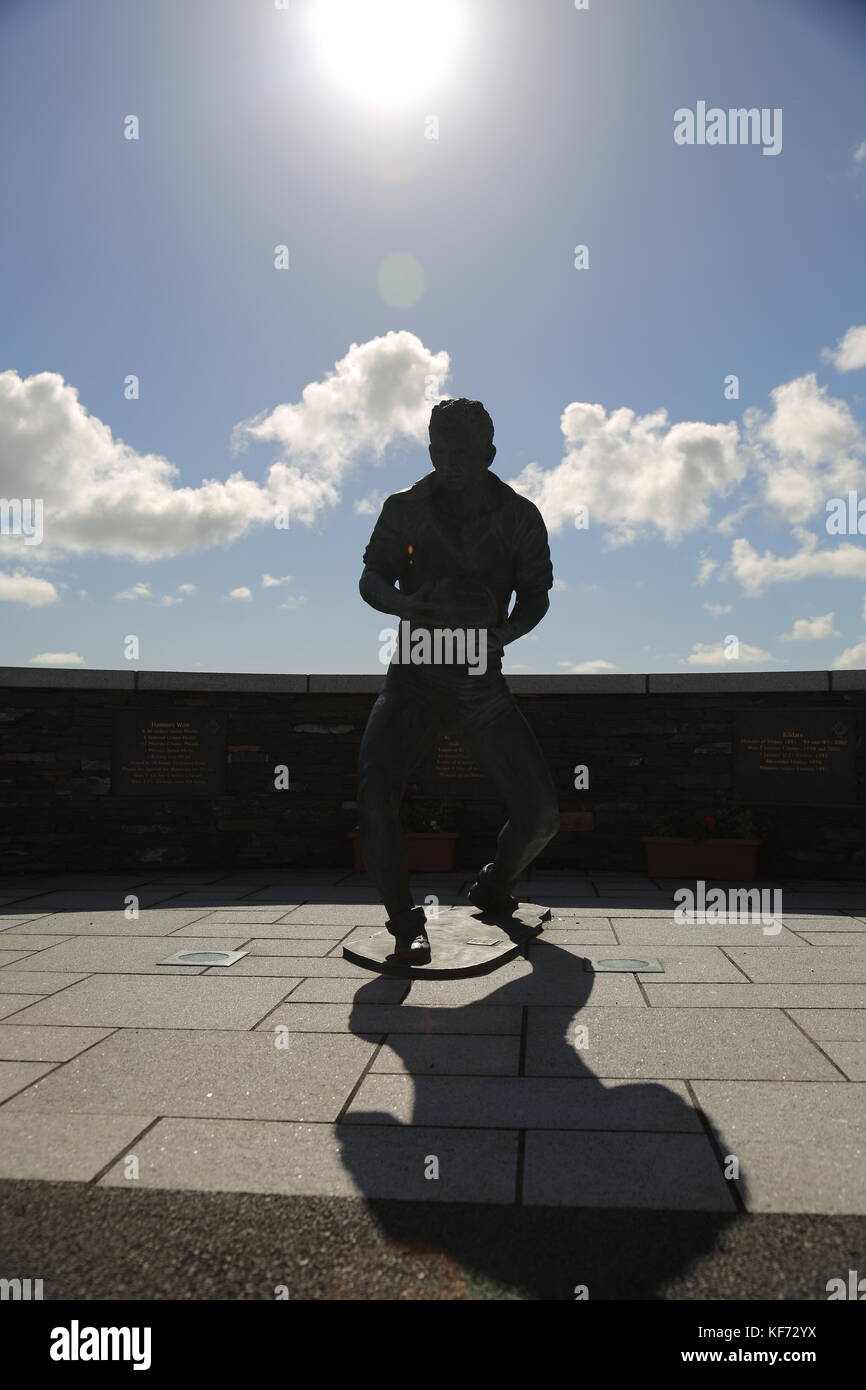 Statue of Kerry footballer in sports gear with football. - Stock Image