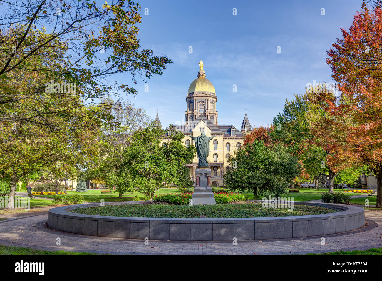 NOTRE DAME, IN/USA - OCTOBER 19, 2017:  Jesus Statue and Golden Dome on the campus of Notre Dame University. - Stock Image