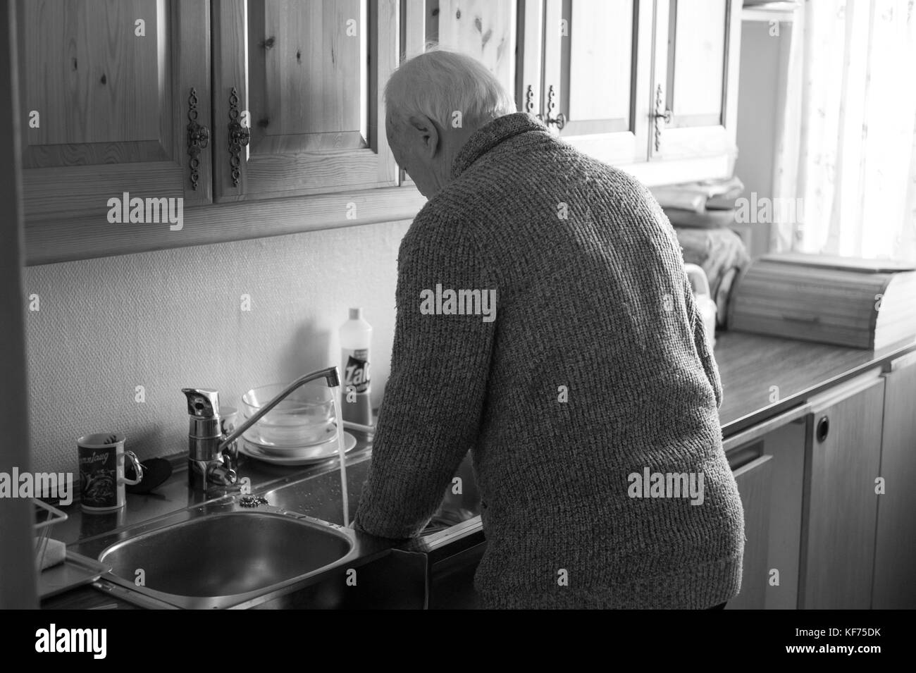 Doing the dishes as he always have done - Stock Image