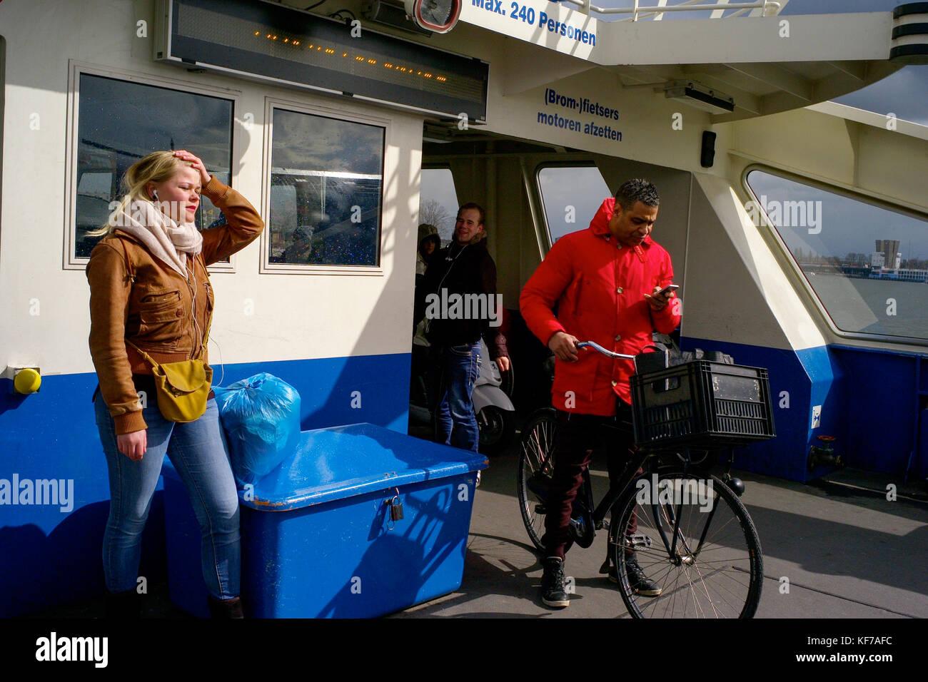 Ferry-boat crosses Ij-river, Amsterdam, Netherlands - Stock Image