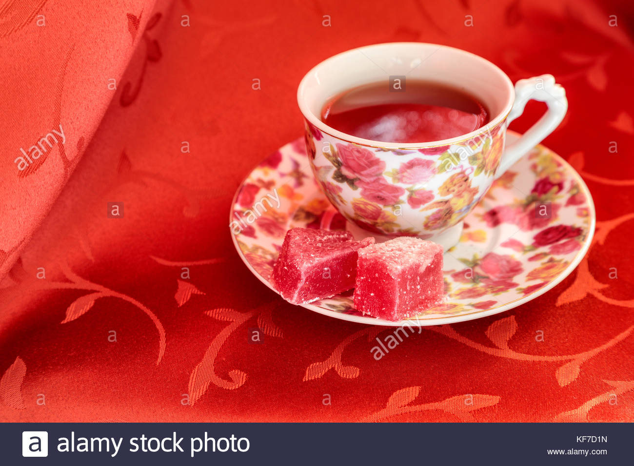 Mostar, Bosnia and Herzegovina. Tea cup with turkish delight lokum in red background - Stock Image