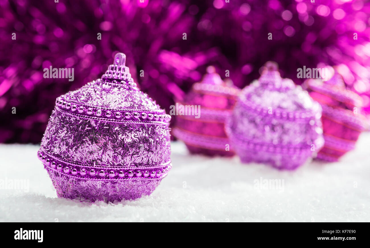 Weihnachtskugeln Pink.Pink And Purple Christmas Balls In Snow With Tinsel Christmas Stock