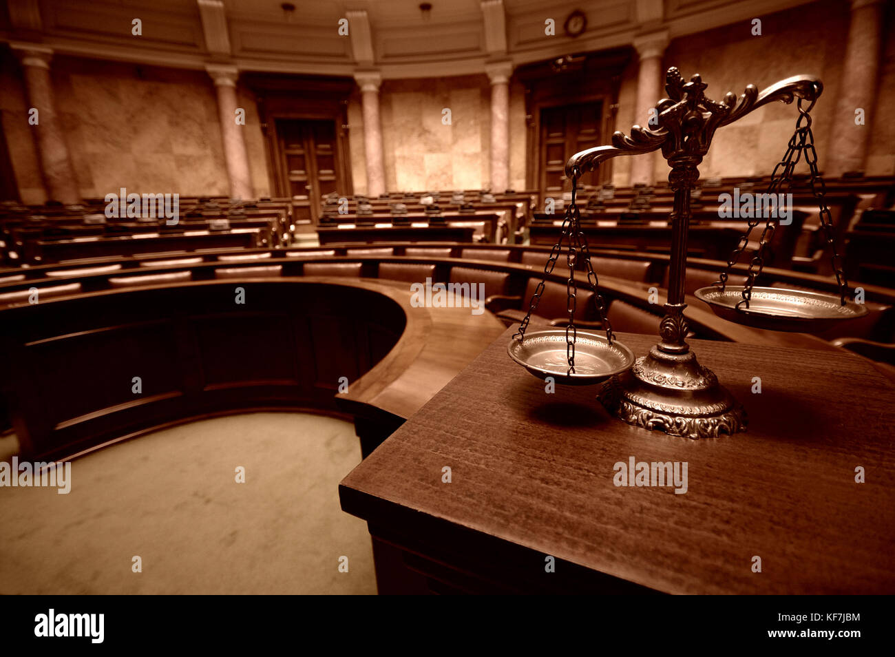 Symbol of law and justice in the empty courtroom, law and justice concept. - Stock Image