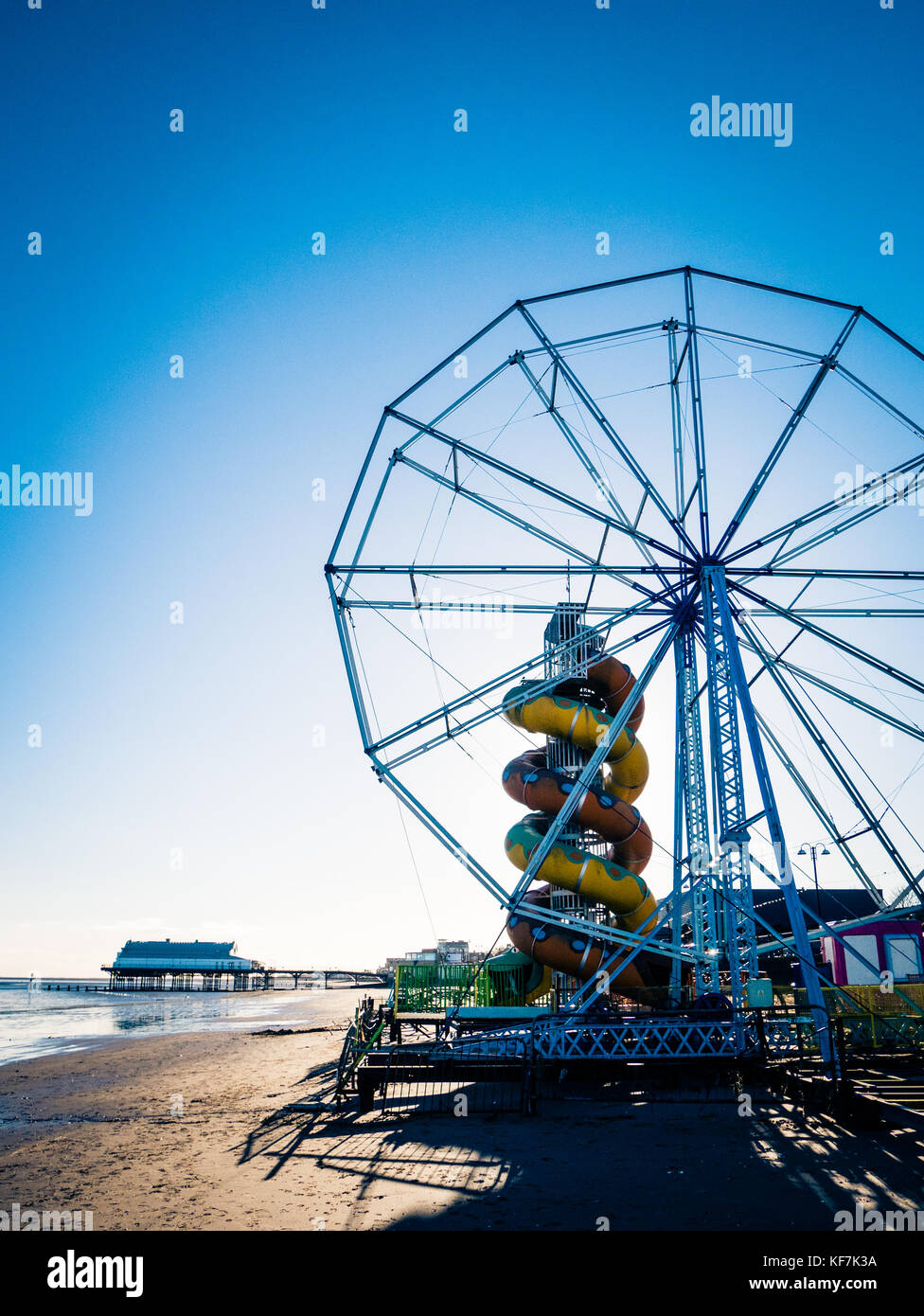 Ferris Wheel, Helter Skelter and Pier at the seaside of Cleethorpes Lincolnshire England UK - Stock Image