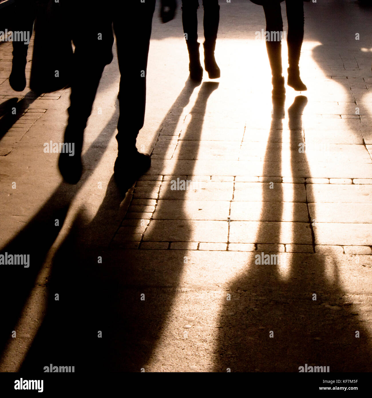 Blurry shadow and silhouette of people walking on the city street Stock  Photo - Alamy