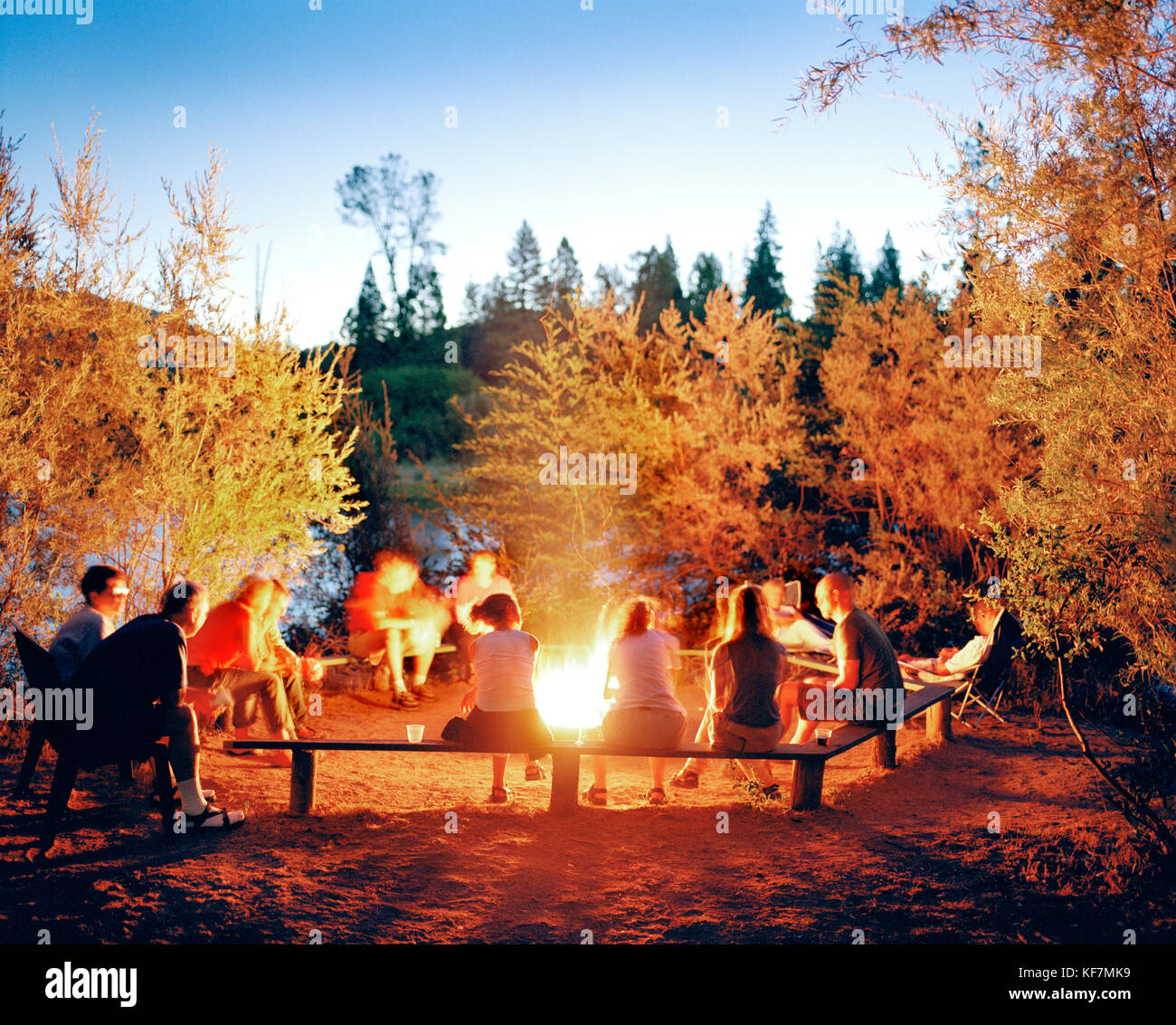 USA, California, Coloma, campfire at dusk by the South Fork of the American River - Stock Image
