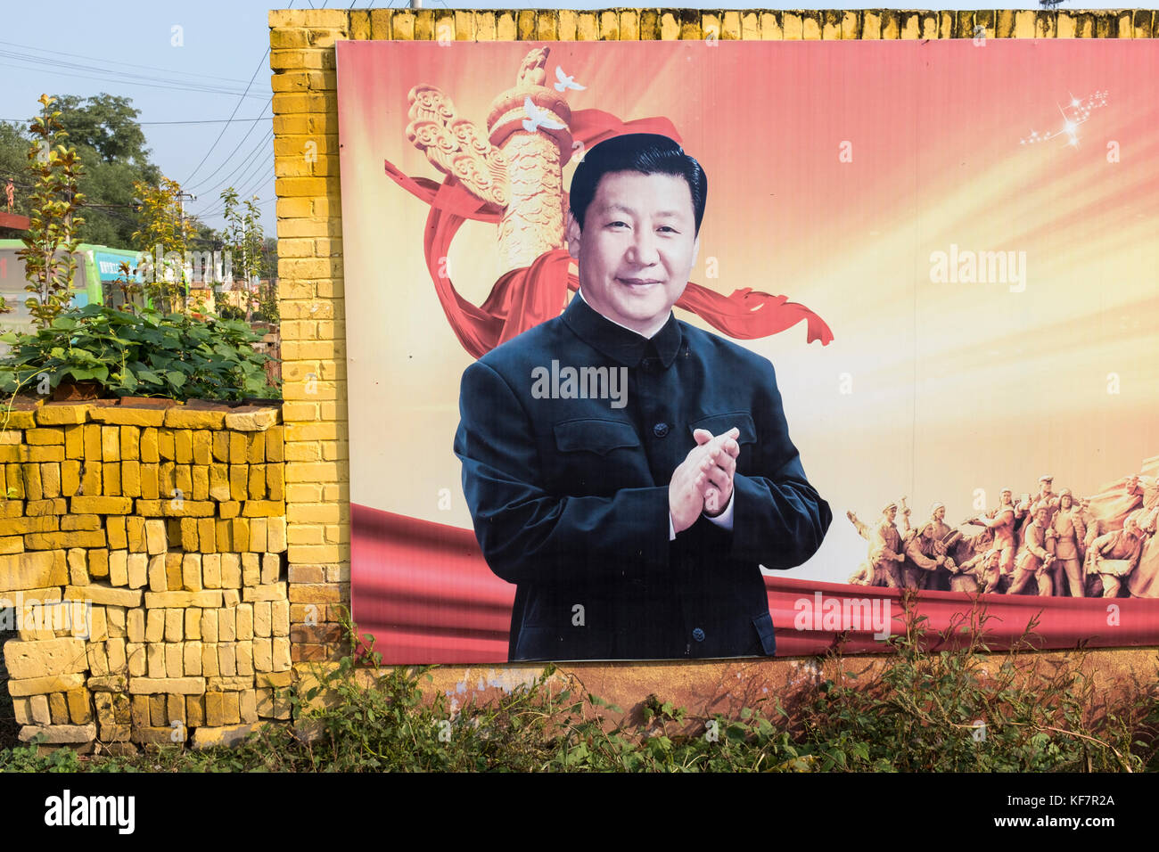A poster featuring Xi Jinping, China's president, hangs on a wall in a village in Xiong'an New Area, Hebei - Stock Image