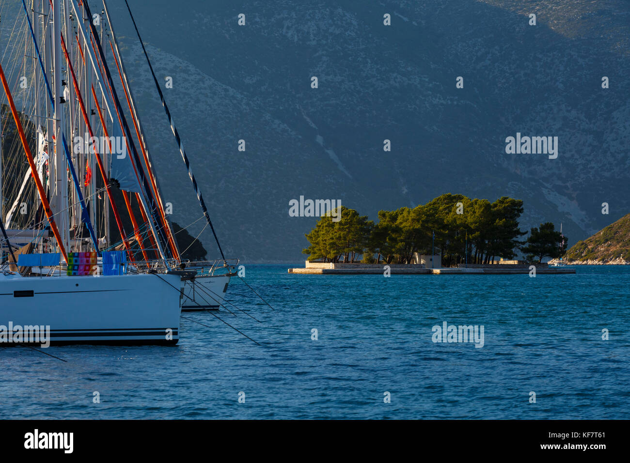 Sailboat and an islet in the Molos Gulf in Ithaca island, Greece. - Stock Image